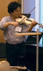 Nori Tagawa tries out the 'bad violin'